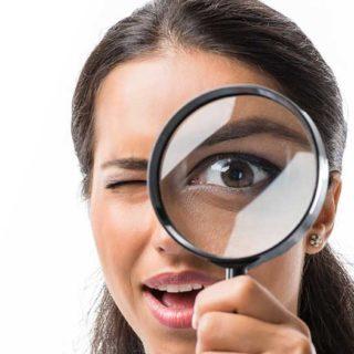 Female Using Magnifying Glass - Banner image for Spotting the Leak Blog