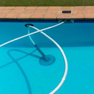 Swimming Pool with Cleaner - Banner image for How to Avoid a Pool Overflow – Useful Tips Blog