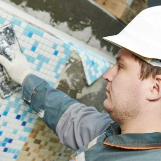Male Swimming Pool Contractor Wearing Safety Helmet - Banner Image for Can You Insure your Swimming Pool Contractor? Blog