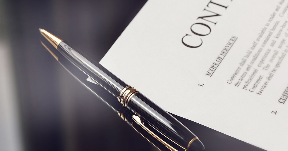 Contract And Pen - Banner Image for Beware of the Suit - The Importance of Contracts Prior to Starting Work Blog